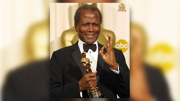 Sidney Poitier poses with his honorary Oscar March 24, 2002 at the 74th Academy Awards; LEE CELANO/AFP via Getty Images